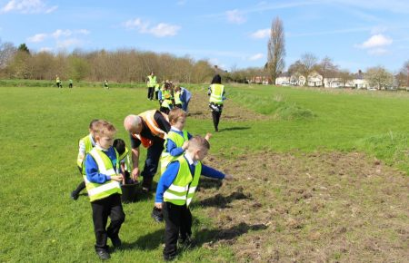 Children sowing poppy seeds